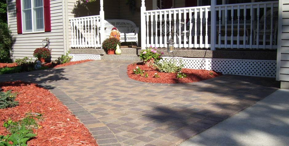 We deliver and spread rock, mulch and edging for your home or business in the South Metro.